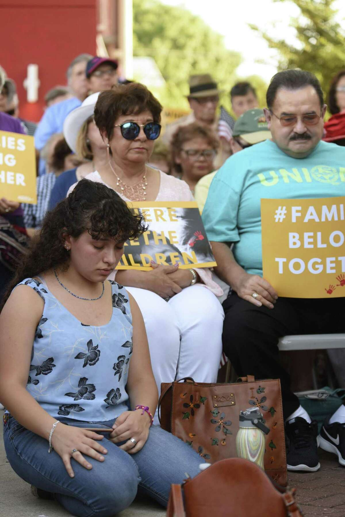 People pray during a rally in support of immigrant children and families, led by U.S. Rep. Joaquin Castro, the Texas Organizing Project, MALC, RAICES and other groups, at the Guadalupe Cultural Center on Thursday, May 31, 2018.