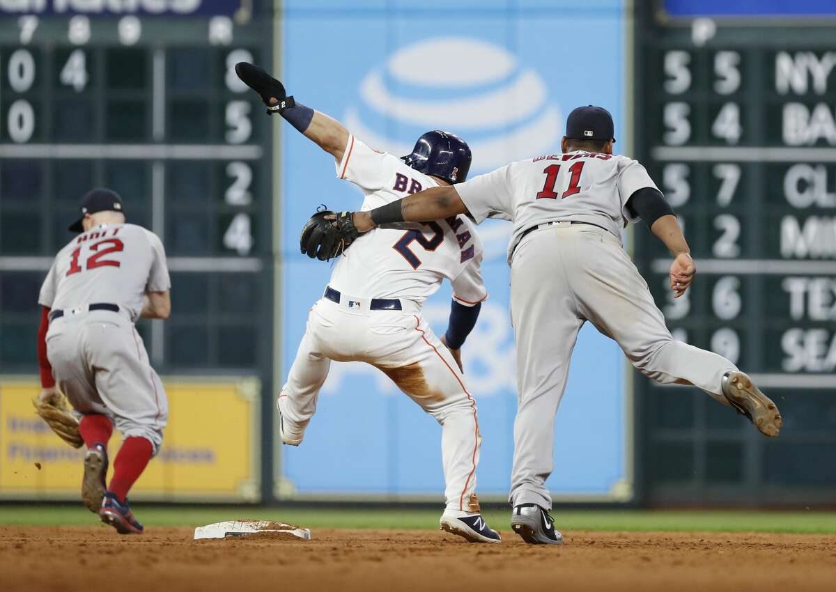 Houston Astros Alex Bregman (2) gets tangled with Boston Red Sox third baseman Rafael Devers (11) at second base during the eighth inning of an MLB baseball game at Minute Maid Park, Thursday, May 31, 2018, in Houston. ( Karen Warren / Houston Chronicle )
