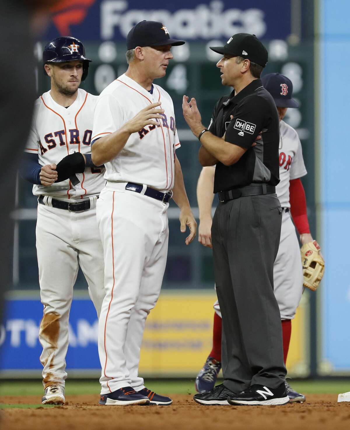 Houston Astros manager AJ Hinch (14) argues the call on Alex Bregman (2) after he got tangled up with Boston Red Sox Rafael Devers at second base during the eighth inning of an MLB baseball game at Minute Maid Park, Thursday, May 31, 2018, in Houston. ( Karen Warren / Houston Chronicle )