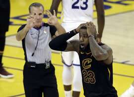Cleveland Cavaliers forward LeBron James (23) reacts to a call during the second half of Game 1 of basketball's NBA Finals between the Golden State Warriors and the Cavaliers in Oakland, Calif., Thursday, May 31, 2018. (AP Photo/Marcio Jose Sanchez)