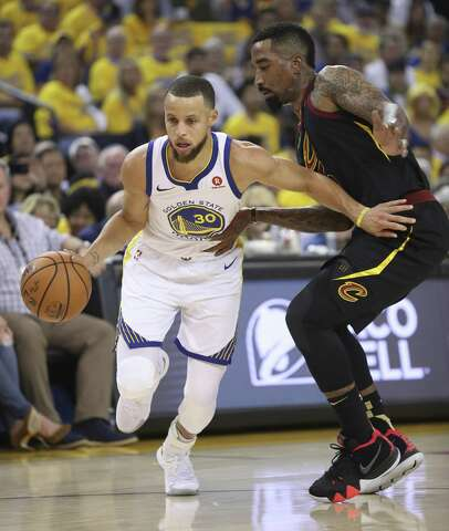 0ea13278cd0 Golden State Warriors  Stephen Curry drives past Cleveland Cavaliers  JR  Smith in the first