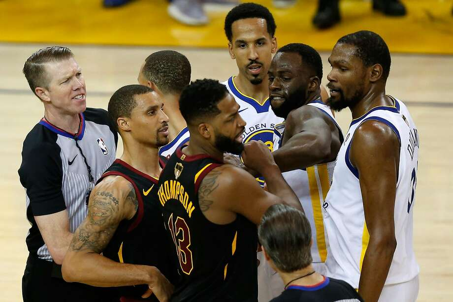 Tristan Thompson #13 of the Cleveland Cavaliers and Draymond Green #23 of the Golden State Warriors get involved in a altercation in overtime during Game 1 of the 2018 NBA Finals at ORACLE Arena on May 31, 2018 in Oakland, California. Photo: Lachlan Cunningham / Getty Images