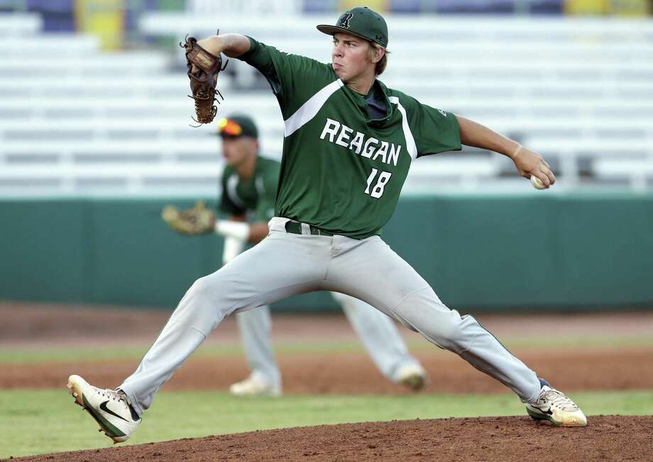 Rattler pitcher Cal Carver delivers in the early innings as Reagan plays Churchill at Wolff Stadium in game 1of the Region IV-6A championship on May 31, 2018. Photo: Tom Reel, Staff / San Antonio Express-News / 2017 SAN ANTONIO EXPRESS-NEWS