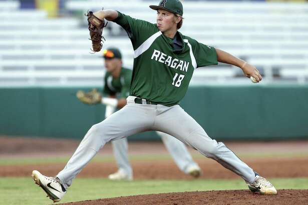 Rattler pitcher Cal Carver delivers in the early innings as Reagan plays Churchill at Wolff Stadium in game 1of the Region IV-6A championship on May 31, 2018.