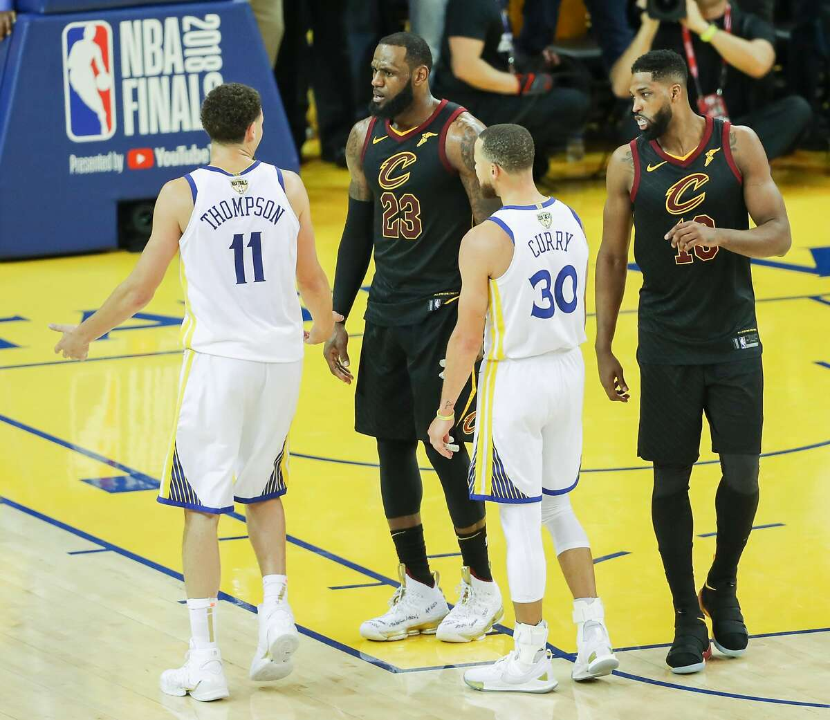 Golden State Warriors' Klay Thompson and Cleveland Cavaliers' LeBron James share words in overtime during game 1 of The NBA Finals between the Golden State Warriors and the Cleveland Cavaliers at Oracle Arena on Thursday, May 31, 2018 in Oakland, Calif.