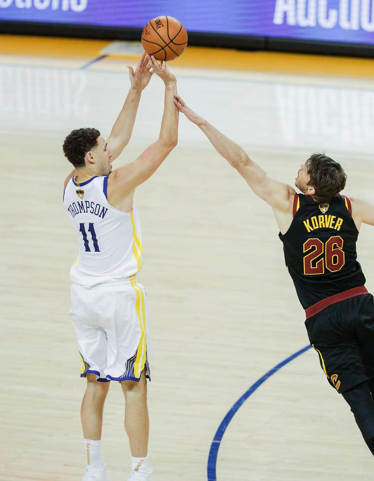 Cleveland Cavaliers' Kyle Korver fouls Golden State Warriors' Klay Thompson in the fourth quarter during game 1 of The NBA Finals between the Golden State Warriors and the Cleveland Cavaliers at Oracle Arena on Thursday, May 31, 2018 in Oakland, Calif.