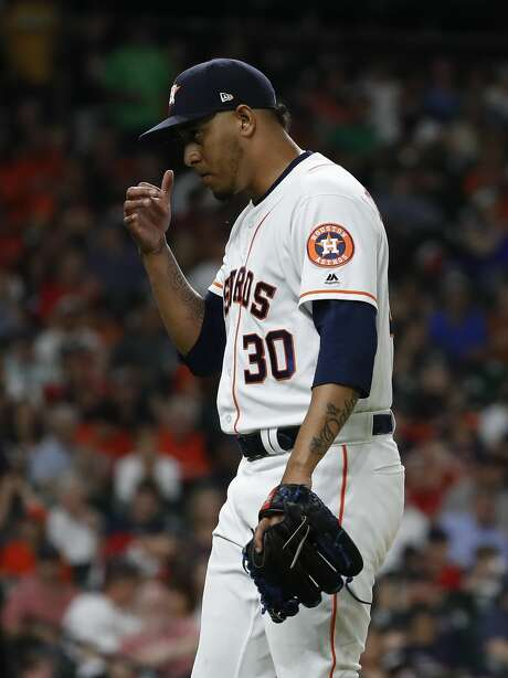 Houston Astros relief pitcher Hector Rondon (30) reacts after getting out of the eighth inning of an MLB baseball game at Minute Maid Park, Thursday, May 31, 2018, in Houston. ( Karen Warren  / Houston Chronicle ) Photo: Karen Warren/Houston Chronicle