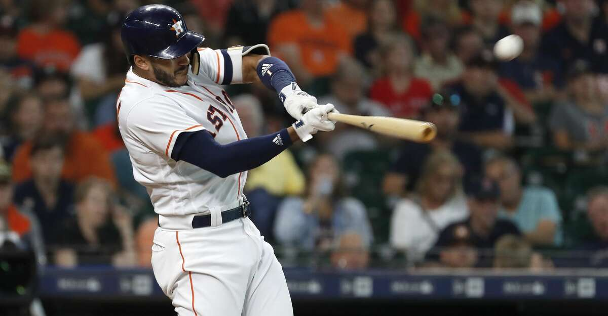 Houston Astros Carlos Correa (1) hits a two-run home run during the first inning of an MLB baseball game at Minute Maid Park, Thursday, May 31, 2018, in Houston. ( Karen Warren / Houston Chronicle )