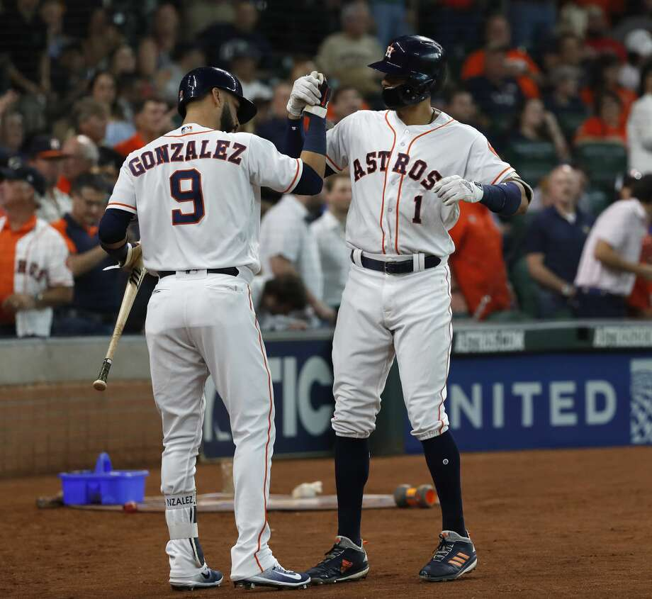 Houston Astros Carlos Correa (1) celebrates with Houston Astros second baseman Marwin Gonzalez (9) after hitting a two-run home run during the first inning of an MLB baseball game at Minute Maid Park, Thursday, May 31, 2018, in Houston. ( Karen Warren  / Houston Chronicle ) Photo: Karen Warren/Houston Chronicle