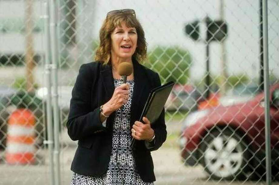 Sharon Mortensen, CEO and president of the Midland Area Community Foundation, announces May 30 that the foundationis investing in the Fairfield Inn & Suites hotel being constructed in downtown Midland. (File Photo)