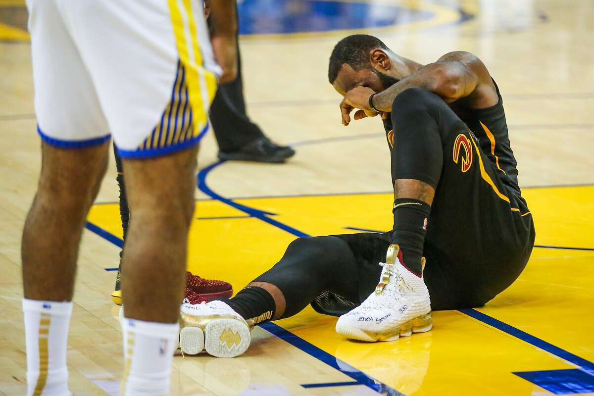 LeBron James (23) gets injured in the second half of Game 1 of the The NBA Finals between the Golden State Warriors and the Cleveland Cavaliers in Oakland, California, on Thursday, May 31, 2018.