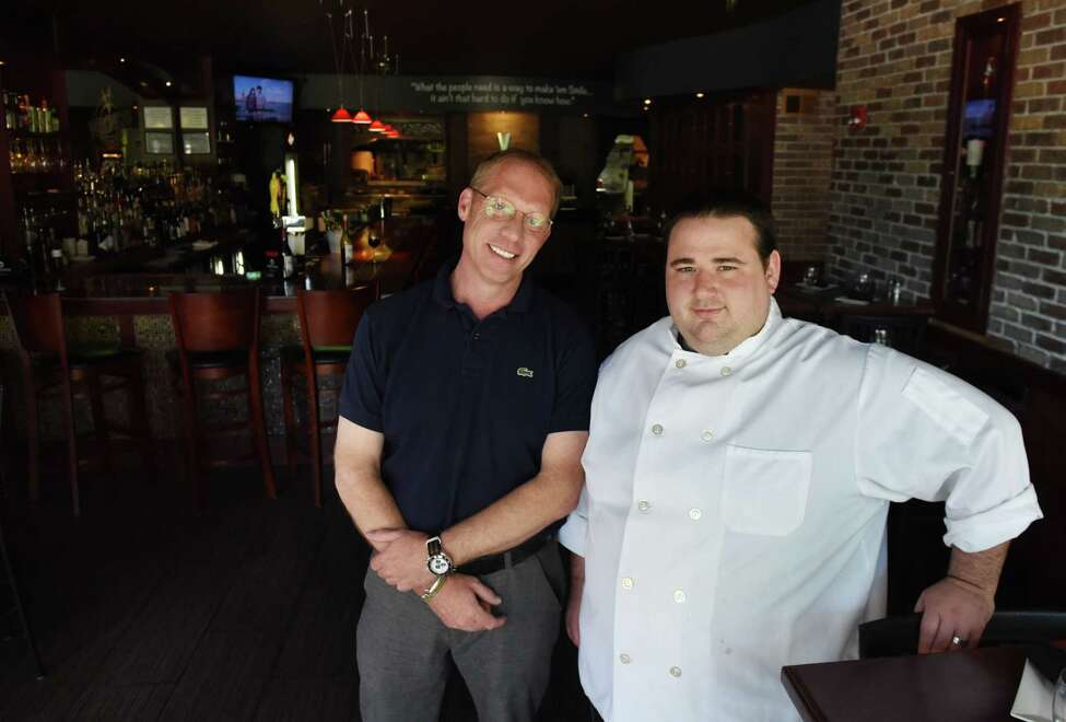 Peter Blackman, proprietor of Veronica's Culinary Tavern, left, and Alex Carusone, executive chef, right, are pictured in the restaurant on Thursday, May 24, in Altamont, N.Y. (Will Waldron/Times Union)