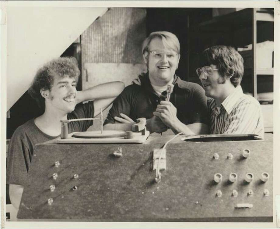 William Dickerson, brothers Scott and John Seeburger in 1979, long after their radio station went off the air.
