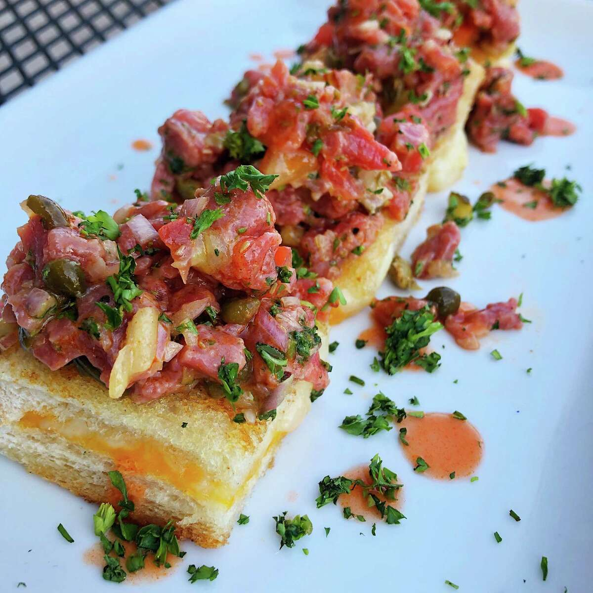Beef tartare tartine (diced raw beef on a five-cheese grilled sandwich at Max's Wine Dive. Chef Brandi Key is now overseeing the culinary program at the popular Houston restaurant and wine bar.