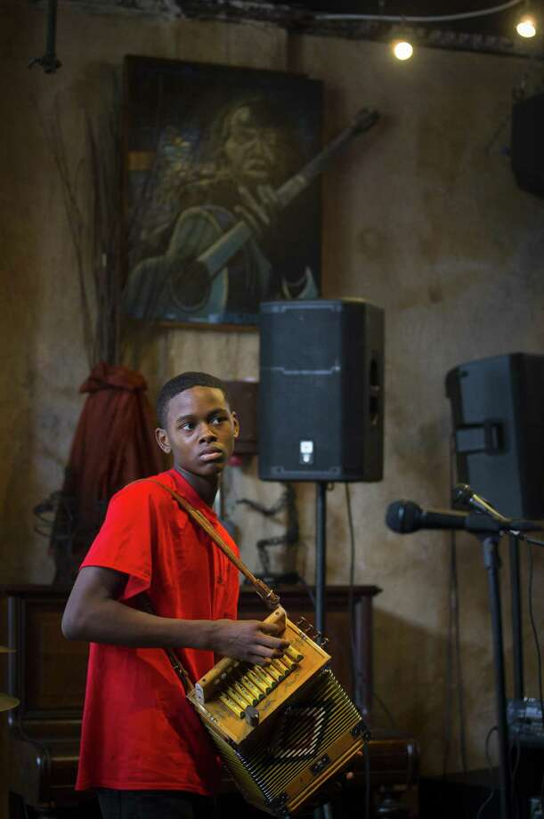 Steven Williams, 14, plays his accordion during the Big Squeeze regional contest for Zydeco players at Cafe 4212 in Houston. Steven got his first accordion as a toddler, but he started getting serious when he was around 10 years-old. He has been playing rub board with zydeco bands for years and also plays drums at his church. Photo: Mark Mulligan, Houston Chronicle / Houston Chronicle / © 2018 Houston Chronicle