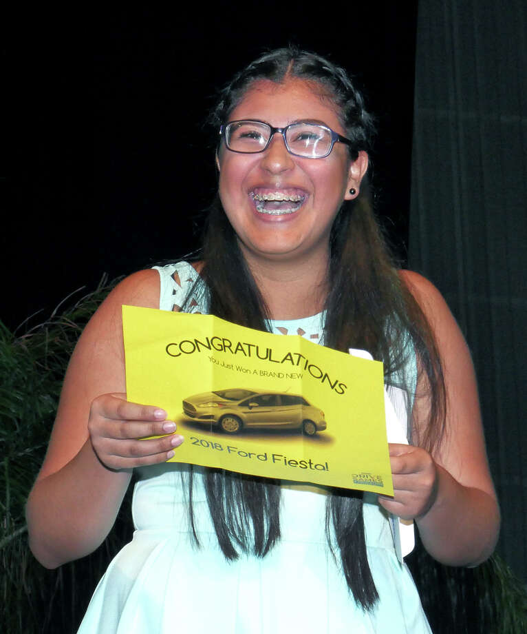 Laredo ISD Early College High School student Karla Carbajo reacts after winning a 2018 Sames Ford Fiesta for her perfect attendance, Thursday, May 31, 2018 at the Laredo Energy Arena. Photo: Cuate Santos/Laredo Morning Times