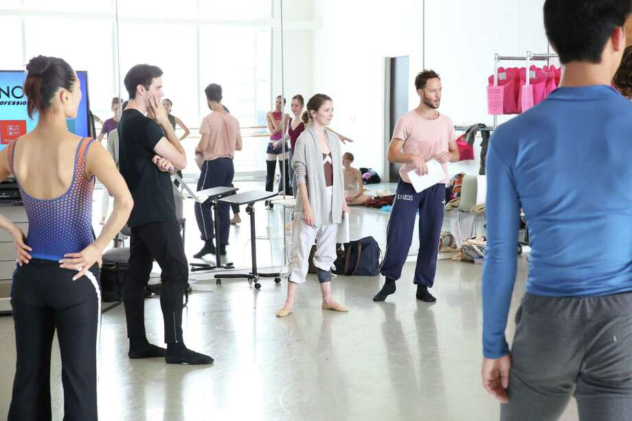 """Choreographers Connor Walsh, Melody Mennite and Oliver Halkowich, center, meet with fellow Houston Ballet dancers during a rehearsal for """"What we keep."""" Photo: Amitava Sarkar / Houston Ballet"""