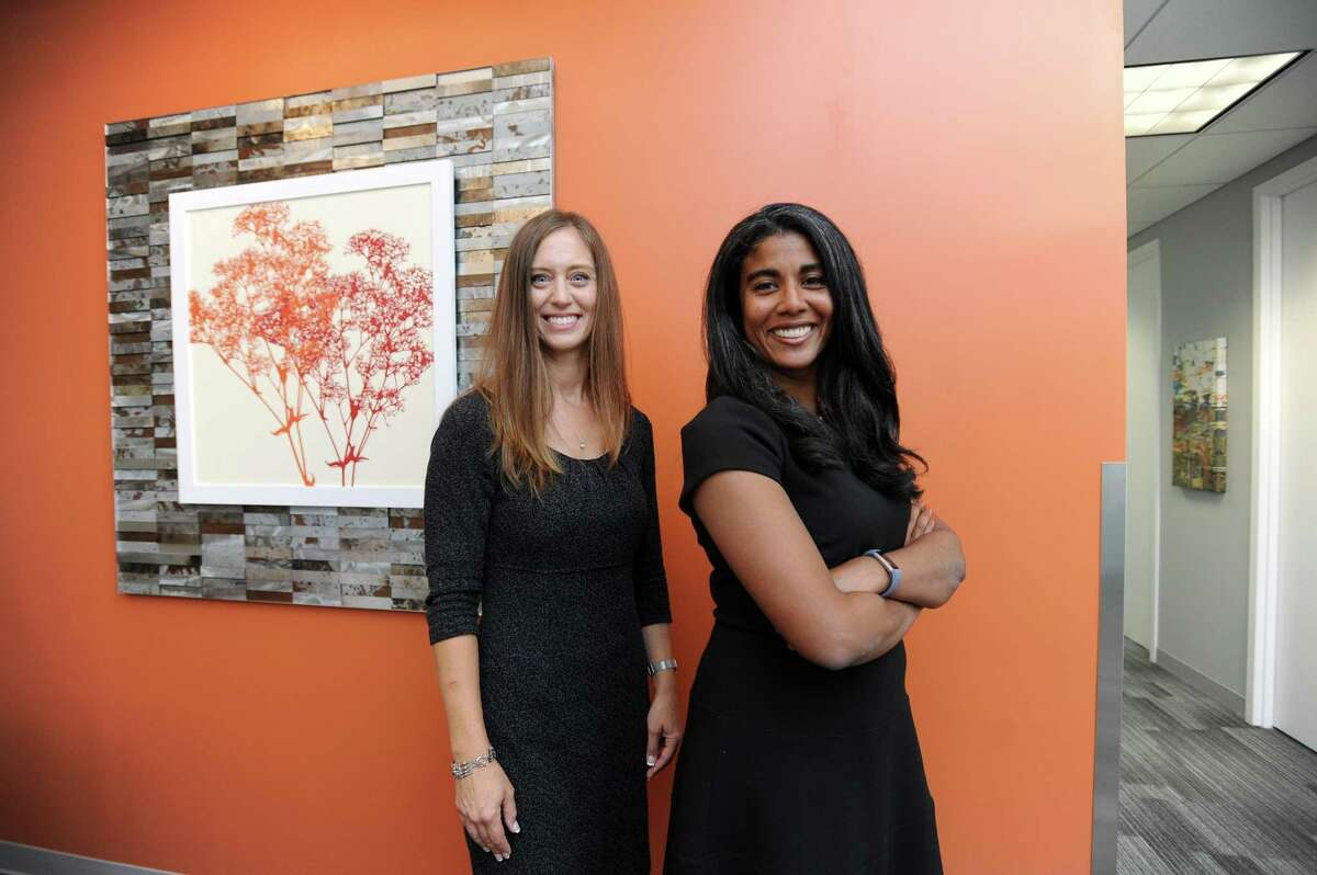 Office Evolution franchise co-owners Nicole Maddox, right, and Rochelle Dede pose for a photo inside the new Office Evolution co-working center at 750 E. Main St., in Stamford, Conn., on Wednesday, May 30, 2018.