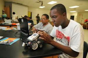 This summer, local children have the opportunity to enroll in camps that focus on the science, technology, engineering and mathematics fields, commonly known as STEM. Spring ISD students, above, worked on a robotic STEM program.