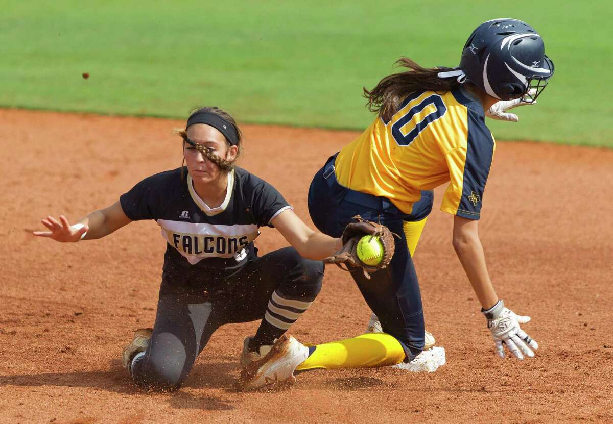 CLASS 5A SEMIFINAL: Foster 8, FW Arlington Heights 1 Ashleigh Sgambelluri #10 of Arlington Heights beats the tag by Foster shortstop Shelby Showers (6) as she steals second base in the fourth inning of a Class 5A state semifinal game during the UIL State Softball Championships at Red & Charline McCombs Field on Friday, June 1, 2018, in Austin.