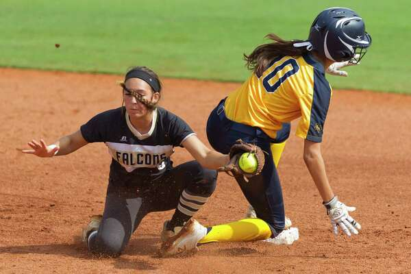 Ashleigh Sgambelluri #10 of Arlington Heights beats the tag by Foster shortstop Shelby Showers (6) as she steals second base in the fourth inning of a Class 5A state semifinal game during the UIL State Softball Championships at Red & Charline McCombs Field on Friday, June 1, 2018, in Austin.
