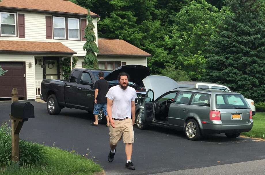 Michael Rotondo, 30, prepares to leave his parents' house in Camillus, N.Y., Friday, June 1, 2018. Rotondo, whose eviction from his parents' home drew national attention finally left Friday, hours before a court-ordered deadline. (Douglass Dowty/The Post-Standard via AP) Photo: Douglass Dowty/AP