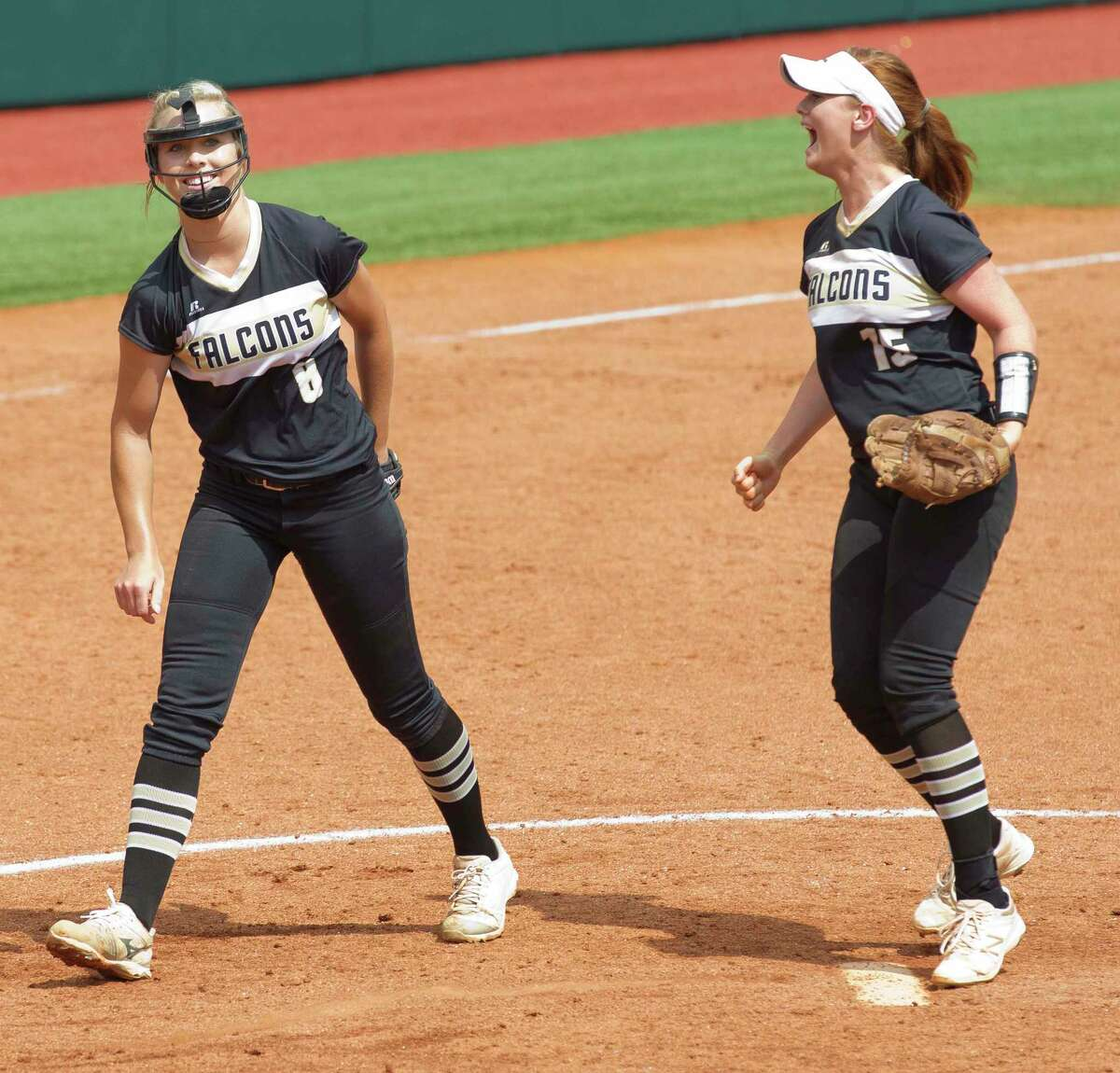 Foster starting pitcher Kacie Pryor reacts beside Foster third baseman Kylie Neel after defeating Arlington Heights 8-1 in a Class 5A state semifinal game during the UIL State Softball Championships at Red & Charline McCombs Field on Friday, June 1, 2018, in Austin.