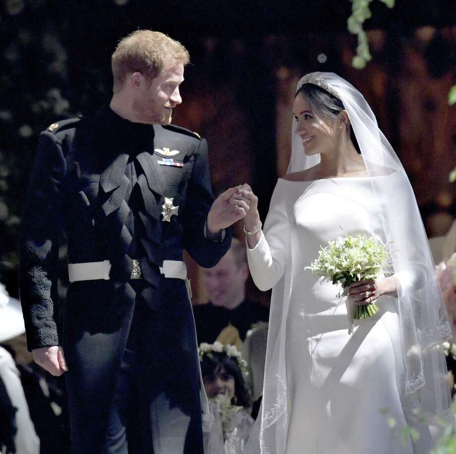 "Prince Harry and Meghan Markle: During the royal wedding watched 'round the world, everyone's favorite redhead relinquished his perennial bachelor title to wed the former ""Suits"" actress and ""The Tig"" blogger. Photo: Brian Lawless, POOL / Associated Press / WPA Rota"