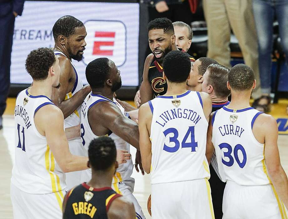 The Warriors' Draymond Green (3rd from right) scuffles with Cleveland's Tristan Thompson at the end of Thursday's game. Photo: Carlos Avila Gonzalez / The Chronicle
