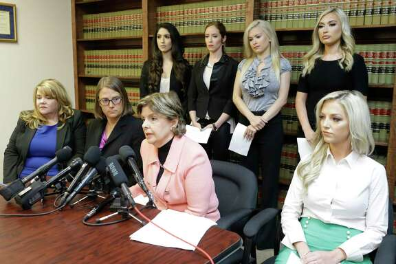 Attorney Gloria Allred speaks during a press conference announcing a lawsuit on behalf of five former Houston Texan NFL cheerleaders shown at the law offices of Kimberley Spurlock, 17280 West Lake Houston Parkway, in Humble,  Friday, June 1, 2018. Shown sitting left are attorneys Misty Cone and Kimberley Spurlock, Gloria Allred with former Houston Texans cheerleaders Kelly Nuner, sitting right, Ashley Rodriguez, standing left, Ainsley Parish, Morgan Wiederhold, and Hannah Turnbow, standing right.