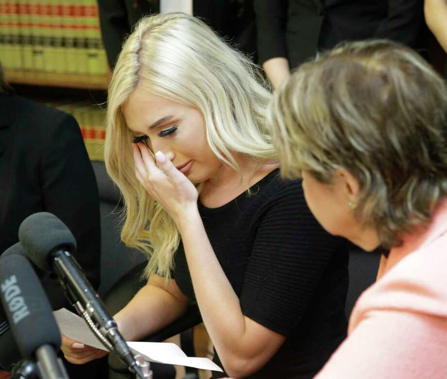 Former Houston Texans cheerleader Hannah Turnbow wipes her tears as she speaks sitting beside attorney Gloria Allred during a press conference announcing a lawsuit on behalf of five former Houston Texan NFL cheerleaders shown at the law offices of Kimberley Spurlock, 17280 West Lake Houston Parkway, in Humble, Friday, June 1, 2018. Photo: Melissa Phillip, Houston Chronicle / © 2018 Houston Chronicle