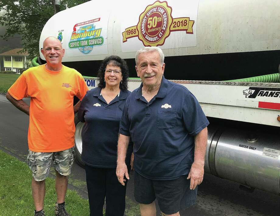 Richard Chiarella II, Carole Chiarella and Richard Chiarella stand in front of their Danbury Septic Tank Service truck at the company's home office in Danbury, Conn., on Friday, June 1, 2018. Photo: Chris Bosak / Hearst Connecticut Media / The News-Times