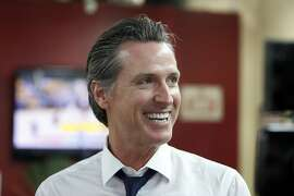 Democratic Lt. Gov. Gavin Newsom smiles at a campaign stop at Stakely's Barber Salon in Los Angeles, Thursday, May 31, 2018. Newsom is the undisputed front-runner in the California governor race and is expected to advance Tuesday. In California primaries, voters choose from candidates of all parties and the top two finishers, regardless of party, advance to the general election. (AP Photo/Damian Dovarganes)