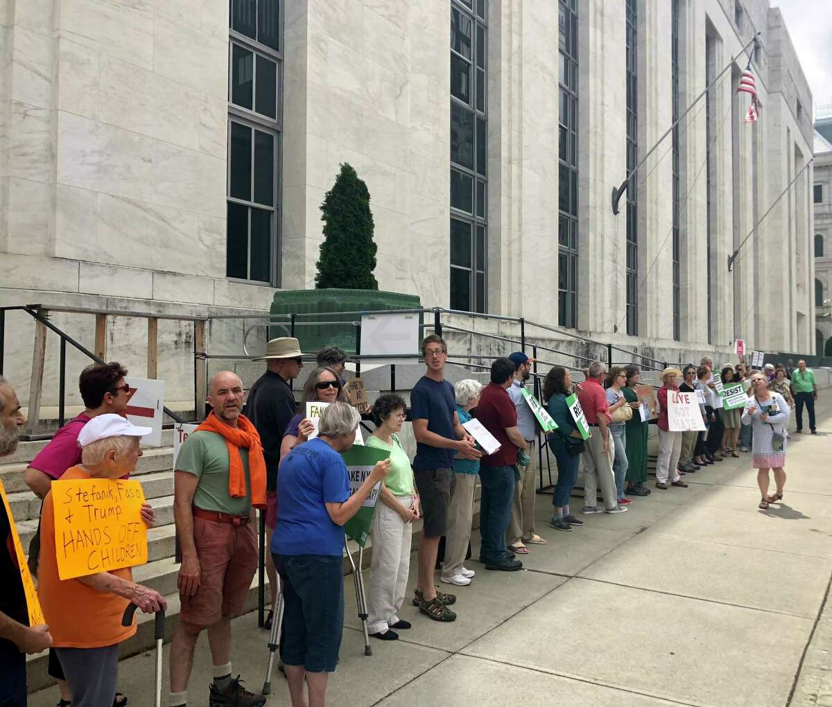 At least two dozen residents gathered in front of the Federal Courthouse in downtown Albany, N.Y. Friday, June 1, 2018 to protest the federal government's handling of and policies regarding immigrant children. (Massarah Mikati / Times Union)