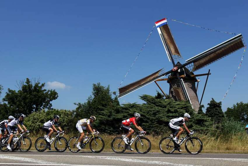 ROTTERDAM, NETHERLANDS - JULY 04: The peloton passes a windmill during stage one of the 2010 Tour de France from Rotterdam to Brussels on July 4, 2010 in Rotterdam, Netherlands. (Photo by Bryn Lennon/Getty Images)