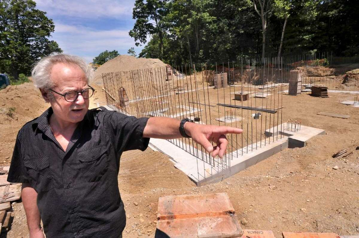 Michael-John Cavallaro, vice chairman of the conservation commission in New Milford, talks about the Indian field on Fort Hill, on Sunday, July 4, 2010. The site is being developed for affordable housing.