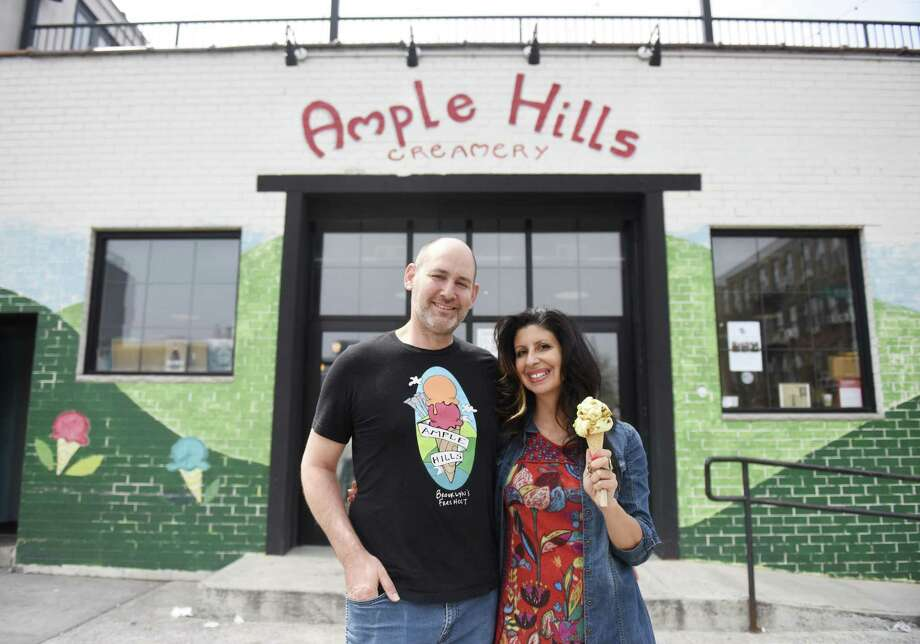 Ample Hills husband-and-wife co-owners Brian Smith, CEO, and Jackie Cuscuna, Chief Culture Officer, pose at Ample Hills Creamery in the Gowanus neighborhood of Brooklyn, N.Y. Thursday, April 12, 2018. Smith and Cuscuna's story of their shop becoming so immediately successful that they ran out of ice cream will appear on the new Rally podcast, hosted by Hearst Connecticut Media business reporter Macaela Bennett. Photo: Tyler Sizemore / Hearst Connecticut Media / Greenwich Time