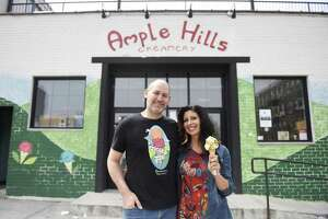 Ample Hills husband-and-wife co-owners Brian Smith, CEO, and Jackie Cuscuna, Chief Culture Officer, pose at Ample Hills Creamery in the Gowanus neighborhood of Brooklyn, N.Y. Thursday, April 12, 2018. Smith and Cuscuna's story of their shop becoming so immediately successful that they ran out of ice cream will appear on the new Rally podcast, hosted by Hearst Connecticut Media business reporter Macaela Bennett.