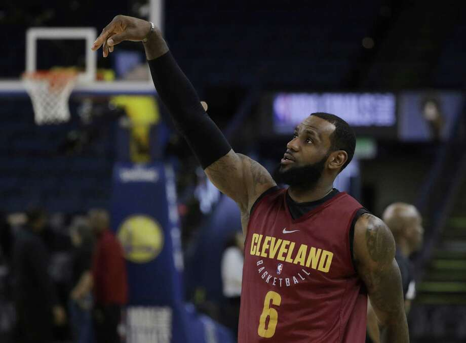 Cleveland's LeBron James follows through on a shot during an NBA basketball practice Wednesday in Oakland, Calif. If James does not win a title this year will he leave Cleveland again? Photo: Marcio Jose Sanchez /Associated Press / Copyright 2018 The Associated Press. All rights reserved.