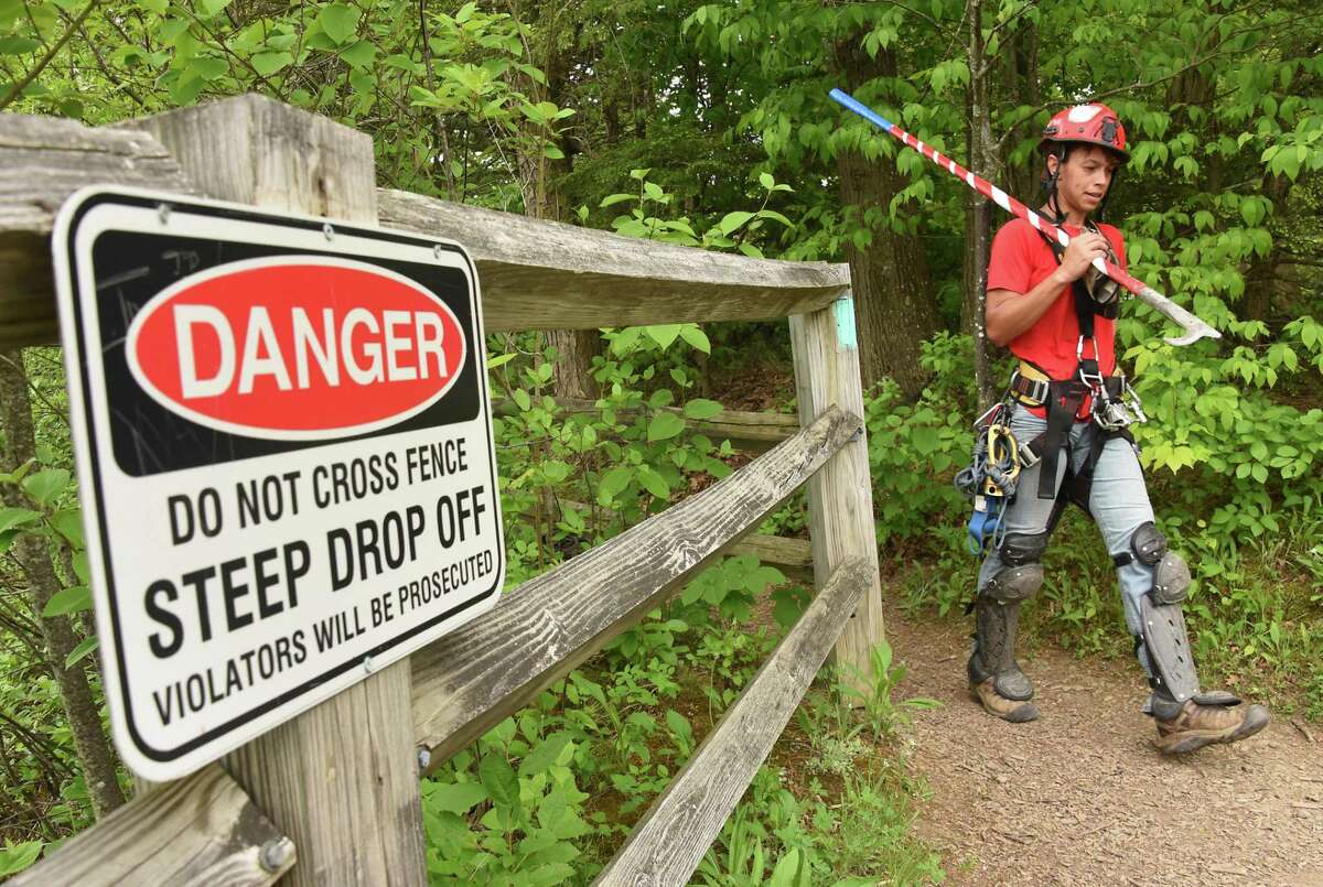 Rachel Bowman, a member of New York State Parks Recreation & Historic Preservation scaling team, returns after rappelling down the rocky cliff above Indian Ladder Trail at John Boyd Thacher State Park on Thursday, May 31, 2018 in New Scotland, N.Y. The scaling team, out of Ithaca, was dislodging loose rocks to reduce the risk of rockfall to hikers below. (Lori Van Buren/Times Union)