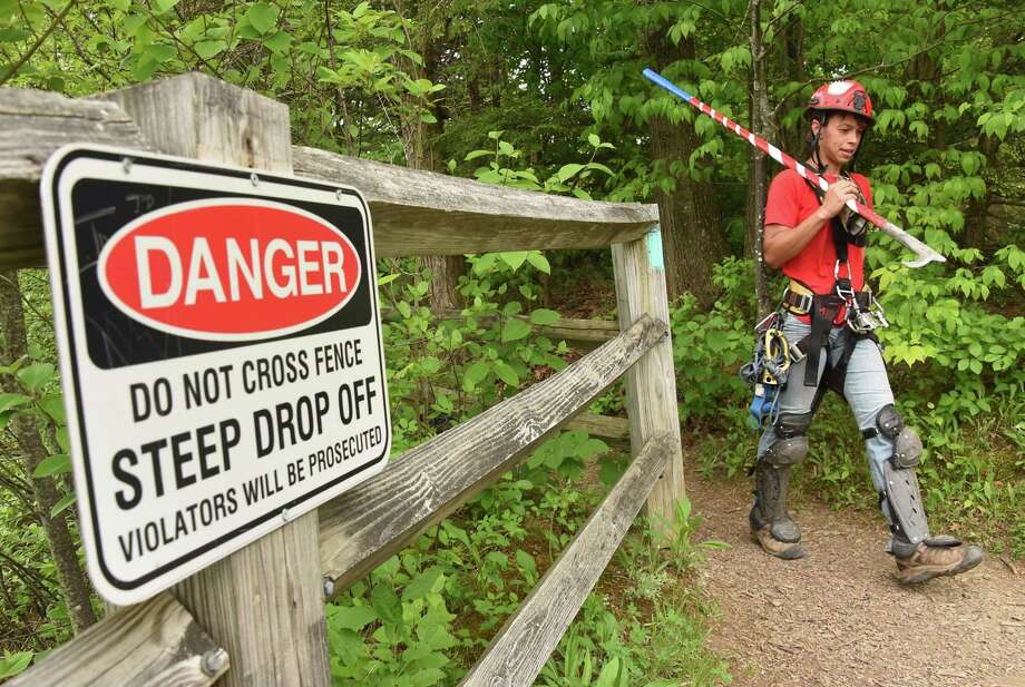 Rachel Bowman, a member of New York State Parks Recreation & Historic Preservation scaling team, returns after rappelling down the rocky cliff above Indian Ladder Trail at John Boyd Thacher State Park on Thursday, May 31, 2018 in New Scotland, N.Y. The scaling team, out of Ithaca, was dislodging loose rocks to reduce the risk of rockfall to hikers below. (Lori Van Buren/Times Union) Photo: Lori Van Buren, Albany Times Union