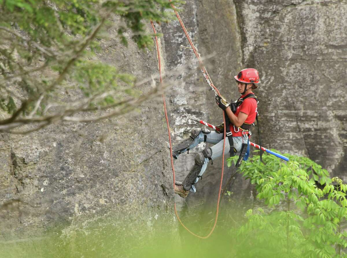 Rachel Bowman of the scaling team rappels down the rocky cliff above Indian Ladder Trail at John Boyd Thacher State Park on Thursday, May 31, 2018 in New Scotland, N.Y. The scaling team, out of Ithaca, was dislodging loose rocks to reduce the risk of falling rocks onto the trail below.(Lori Van Buren/Times Union)