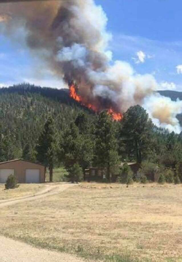 The Latest: New Mexico wildfire threatens more homes - San Francisco ...