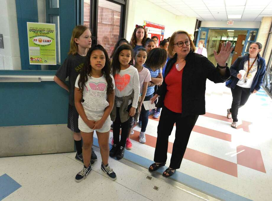 Roton Middle School Guidance Counselor Kathy Mahoney takes a group of 5th grade students from Rowayton Elementary School on a tour of Roton Middle School where they will be going next year on Monday May 21, 2018 in Norwalk Conn. Photo: Alex Von Kleydorff / Hearst Connecticut Media / Norwalk Hour