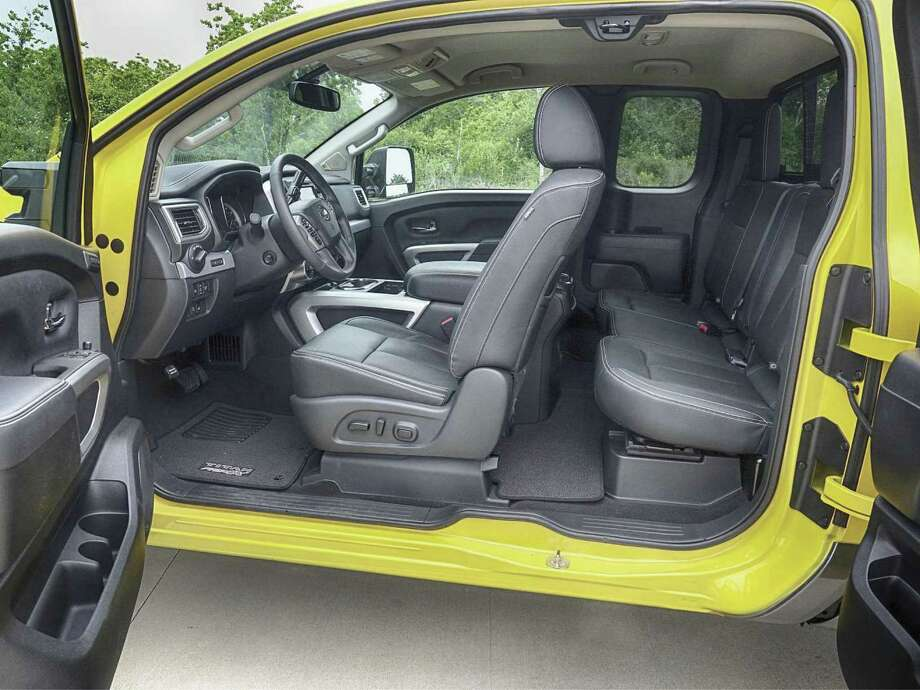 Titan XD King Cab Pro-4X has standard front bucket seats and 60/40 split fold-down rear seats with center flip-down center armrest. (Jeff Yip photo)