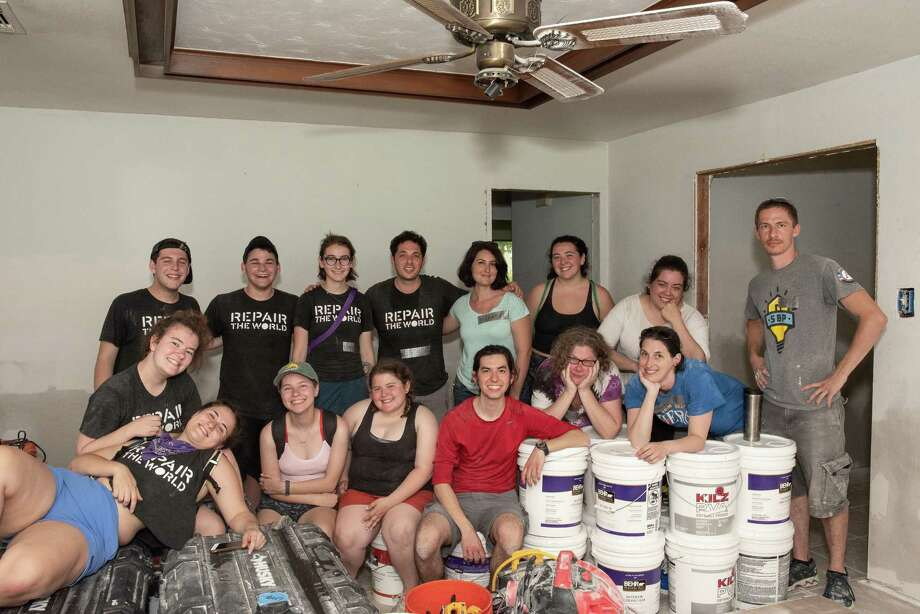 Repair the World volunteers helped to rebuild a home along with SBP volunteers during their time in Houston. Repair the World is an organization that provides young Jewish people with volunteer opportunities. College aged alumni from the Detroit group helped in Houston over Memorial Day weekend. Photo: John Huang Photography. / JOHN HUANG