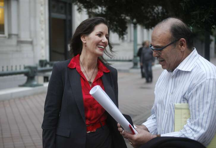 Oakland Mayor Elect, Libby Schaaf, left, chats with Oakland City worker Thomas Espinosa, who is with the Communications and Economic Development Agency as she gets her portrait taken for the Chronicle Dec. 10, 2014 in Oakland, Calif.
