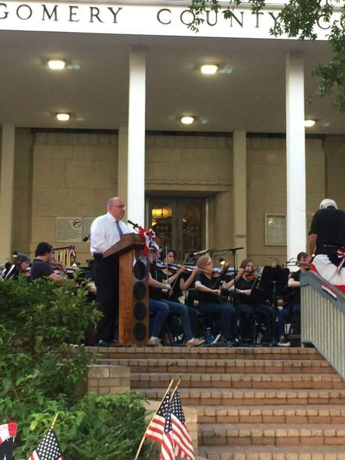 Precinct 1 Justice of the Peace Wayne Mack speaks at the Conroe Symphon Orchestra's patriotic concert in 2017 on the courthouse steps. This year's patriotic concert is set for June 30 and it will take place at Heritage Place Park in downtown Conroe. / Internal