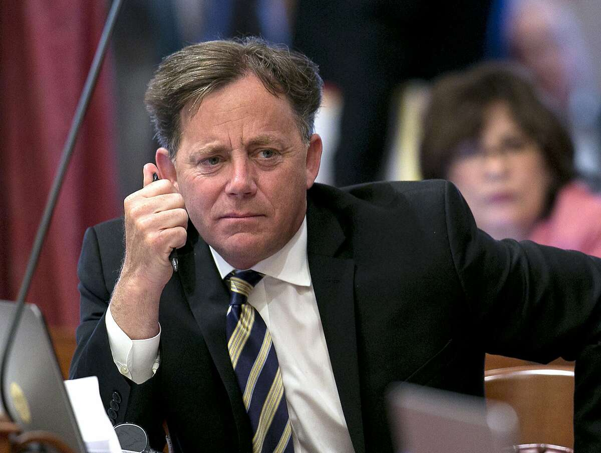 FILE - In this June 15, 2017 file photo, state Sen. Josh Newman, D-Fullerton, listens as lawmakers debate a measure to change the rules governing recall elections, at the Capitol in Sacramento, Calif. Newman is facing a challenge from Republicans in his upcoming re-election campaign from those who opposed his vote to increase the California gasoline tax. (AP Photo/Rich Pedroncelli, File)