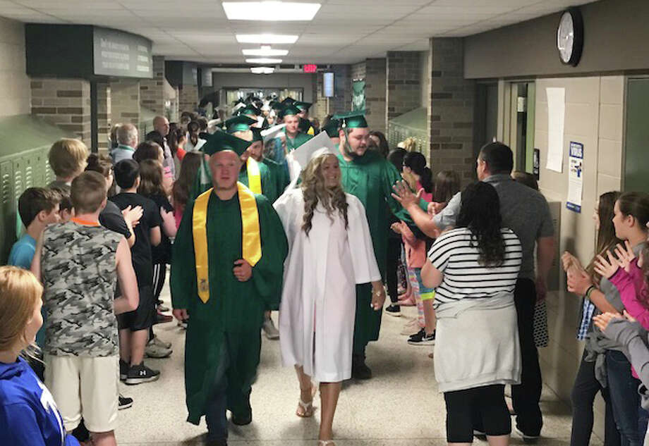 Right after graduation practice, Laker seniors walked the secondary school and elementary school halls Thursday morning, wearing their caps and gowns. Staff members and students cheered them on and gave them high fives. This has become a tradition at Lakers, and it reminds the younger students why they need to continue working hard — graduation is the ultimate goal. Photo: Submitted Photo